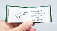BNPS.co.uk (01202) 558833<br /> Pic: PeterHarrington/BNPS<br /> <br /> Rowling has done original drawings of equipment including quills, scales, a cauldron and a wizard's hat.<br /> <br /> A unique miniature Harry Potter book created by JK Rowling has emerged for sale for £125,000.<br /> <br /> The author hand-wrote and illustrated the 31 page green leather bound manuscript measuring just 1.5ins by 2.5ins for a charity auction in 2004.<br /> <br /> It contains the passage on pages 52-53 of Harry Potter and The Philosopher's Stone where Harry and Hagrid go to London to buy school supplies for Hogwarts.<br /> <br /> Rowling has done original drawings of equipment including quills, scales, a cauldron and a wizard's hat.