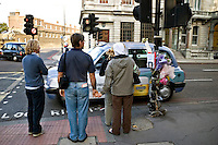 Flower tributes attached to traffic lights for a young lady killed in a road traffic accident in Victoria central London England..©shoutpictures.com..john@shoutpictures.com