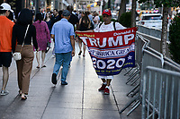USA, New York City, Donald Trump supporter with banner for re-election of Trump for president in 2020 in front of Trump tower at 5th Avenue , slogan on his banner: TRUMP keep America great ! / Trump Wähler und Befuerworter mit Wiederwahl 2020 Plakat vor dem Trump Tower