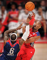 In one of the highlights of the NBA All-Star game in Houston, Kobe Bryant blocks Lebron James. (Travis Bell/SIDELINE CAROLINA/for ESPN Images)