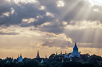 Sun-rays at sunset over Sagaing Hills and the Irrawaddy River, Mandalay, Myanmar