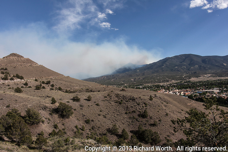 Wildfire smoke floats in the sky east of Salida, Colorado, June 19, 2013.  Tenderfoot Mountain is to the left of the frame.