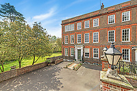 BNPS.co.uk (01202 558833)<br /> Pic: KnightFrank/BNPS<br /> <br /> Pictured: Outside the property.<br /> <br /> A spectacular Georgian mansion that was home to an eccentric and legendary poet during the war is on the market for £10.5m.<br /> <br /> Grade II* Listed South End House was home to Walter de la Mare in the 1940s and the writer was reprimanded for failing to observe the blackout during the Second World War.<br /> <br /> The impressive property is in a prime location on an exclusive cul-de-sac with incredible park views and glimpses of the Thames.<br /> <br /> On one occasion during the war, police rowed across the river to complain his upper windows were beaconing to the far bank.