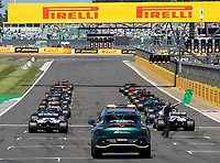 18th July 2021; Silverstone Circuit, Silverstone, Northamptonshire, England; Formula One British Grand Prix, Race Day; The green flag is waved as the red lights come on to start the race