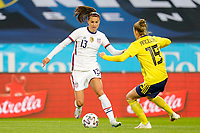 SOLNA, SWEDEN - APRIL 10: Alex Morgan #13 of the United States turns with the ball during a game between Sweden and USWNT at Friends Arena on April 10, 2021 in Solna, Sweden.