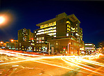 exterior of large urban hospital (Beth Israel Deaconess in Boston) lit up at night, busy traffic in intersection