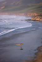 Windsurfer walking from the water at Jalama Beach Park Lompoc California