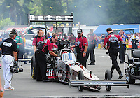 Aug. 7, 2011; Kent, WA, USA; NHRA top fuel dragster crew members for driver Larry Dixon during the Northwest Nationals at Pacific Raceways. Mandatory Credit: Mark J. Rebilas-