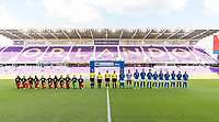 ORLANDO, FL - FEBRUARY 24: Canada and Brazil line up during the national anthems before a game between Brazil and Canada at Exploria Stadium on February 24, 2021 in Orlando, Florida.
