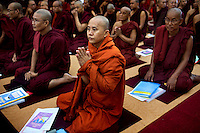 U Wirathu, the spiritual leader of the Buddhist nationalist '969' movement prays with other senior monks at a Buddhist conference on communal violence in Hmawbi, near Yangon. Wirathu was pushing for a new law that banned Muslim men from marrying Buddhist women. /Felix Features
