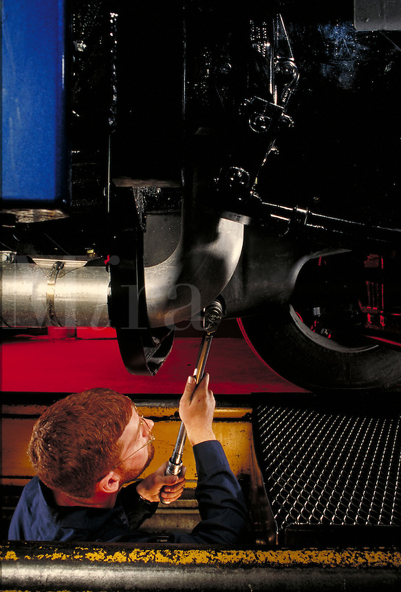 mechanic working under 18-wheeler