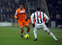 Pictured L-R: Scott Sinclair of Swansea against Jerome Thomas of West Bromwich. Saturday, 04 February 2012<br /> Re: Premier League football, West Bromwich Albion v Swansea City FC v at the Hawthorns Stadium, Birmingham, West Midlands.