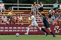 NEWTON, MA - AUGUST 29: Jenna Bike #4 of Boston College dribbles down the wing during a game between University of Connecticut and Boston College at Newton Campus Soccer Field on August 29, 2021 in Newton, Massachusetts.