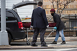 The body of a COVID-19 victim is wheeled into a van from a refrigerated trailer serving as a temporary morgue during the coronavirus pandemic (COVID-19) in front of New York Community Hospital in the Brooklyn borough of New York City on April 5, 2020.  Photograph by Michael Nagle