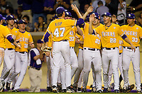 Ben Alsup #47 of the LSU Tigers is congratulated by teammates after getting out of a bases loaded, no out jam in the top of the first inning against the Wake Forest Demon Deacons at Alex Box Stadium on February 18, 2011 in Baton Rouge, Louisiana.  The Tigers defeated the Demon Deacons 15-4.  Photo by Brian Westerholt / Four Seam Images