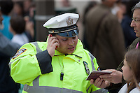 A New York City Traffic Enforcement policewoman assists a tourist on 5th Avenue during the 2011 Easter Parade