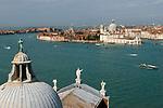 Venice Italy 2009. Room top of church of San Giorgio Maggiore ( foreground ) Canale della Giudecca with water transport. Church of Santa Maria della Salute.