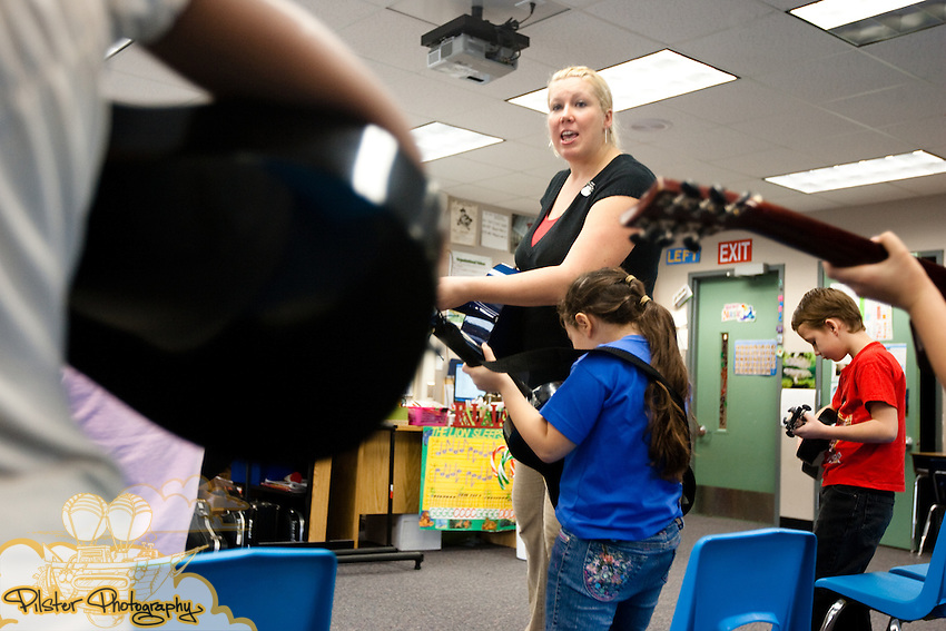 Darci Halloran, a music teacher, teaches a 2nd grade class of students how to play guitars Thursday, December 17, 2009, at Pinewood Elementary School in Mims, Florida. Halloran was awarded a grant to purchase guitars for her music students. (Chad Pilster, http://www.PilsterPhotography.com)