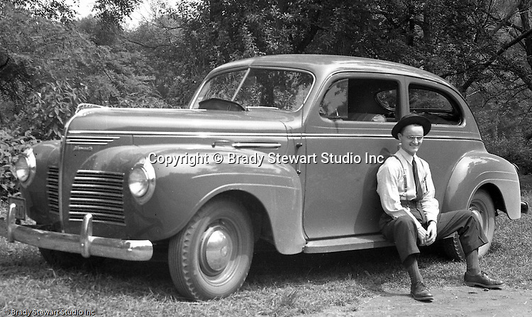 Wilkinsburg PA:  Brady Stewart Jr. with his new Plymouth 2-door Sedan.