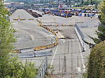 Railroad tracks in yard formerly lead to a barge shipping terminal, now lead to truck loading for container shipping.