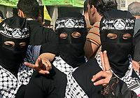 "Palestinian Fatah mask woman  supporters gather at a rally marking the third anniversary of the death of the late Palestinian leader Yasser Arafat in Gaza City, Monday, Nov. 12, 2007. Hamas security forces opened fire at a mass rally commemorating the death of the late Palestinian leader, violently dispersing the largest public display of support for the rival Fatah movement since Hamas seized control of the Gaza Strip in June. Five people were killed and at least 31 were wounded, medical officials and Fatah said.""photo by Fad Adwan"""