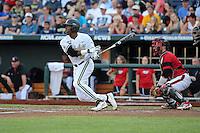 Xavier Turner #9 of the Vanderbilt Commodores bats during Game 2 of the 2014 Men's College World Series between the Vanderbilt Commodores and Louisville Cardinals at TD Ameritrade Park on June 14, 2014 in Omaha, Nebraska. (Brace Hemmelgarn/Four Seam Images)