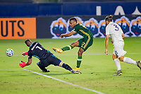CARSON, CA - OCTOBER 07: Jeremy Ebobisse #17 of the Portland Timbers takes a shot past David Bingham #1 GK of the Los Angeles Galaxy during a game between Portland Timbers and Los Angeles Galaxy at Dignity Heath Sports Park on October 07, 2020 in Carson, California.