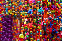 Colorful textile beads in the El Rastero Market, Madrid, Spain