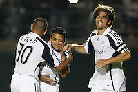 New England Revolution midfielder Mauricio Castro (16) celebrates scoring the final penalty kick with teammates midfielder Brandon Tyler (30) and defender Chase Hilgenbrinck (25). The New England Revolution (MLS) defeated Crystal Palace FC USA of baltimore (USL2) 5-3 in penalty kicks after finishing regulation and overtime tied at 1-1 during a Lamar Hunt US Open Cup quarterfinal match at Veterans Stadium in New Britain, CT, on July 8, 2008.