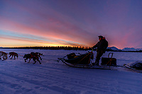Jesse Holmes runs on the lake at sunsrise in the morning at Finger Lake checkpoint during the 2019 Iditarod on Monday March 4, 2019..<br /> <br /> Photo by Jeff Schultz/  (C) 2019  ALL RIGHTS RESERVED