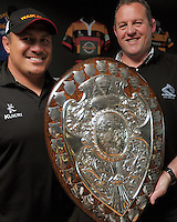Waikato assistant coach Carl Hoeft (left) and head coach Chris Gibbes with the Ranfurly Shield. NZRU unveils refurbished Ranfurly Shield at NZRU Head Office, Wellington, New Zealand on Thursday, 15 November 2012. Photo: Dave Lintott / lintottphoto.co.nz