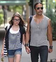 NEW YORK - JUNE 30:  Carlos Leon arrives at Madonna's Apt by bicycle to pick up their daughter Lourdes Maria Ciccone Leon (b. 14-Oct-1996 with Leon) just before husband Guy Richie is due to land in New York. Guy is eligibly flying in to town to talk to Madonna about saving their marriage. On June 30, 2008 in New York City<br /> <br /> People:  Carlos Leon, Lourdes Maria Ciccone Leon