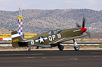 A P-51B Mustang taxies on the ramp prior to a heat race at the Reno National Championship Air Races.