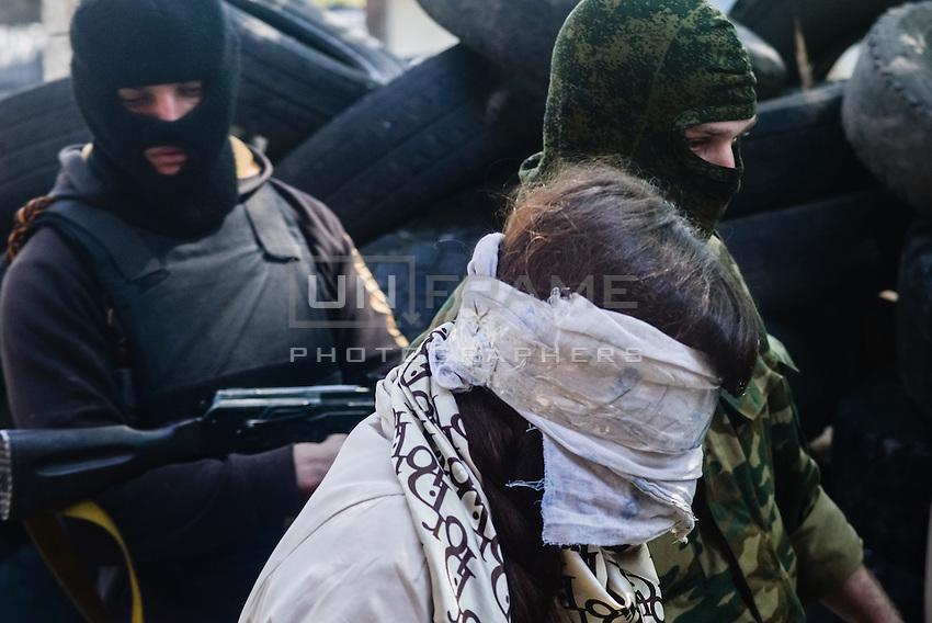 Reporter and Pro-Maidan Irma Krat is taken as hostage by pro-russian activists in Slavyansk city. Slavyansk, Ukraine. April 21, 2014