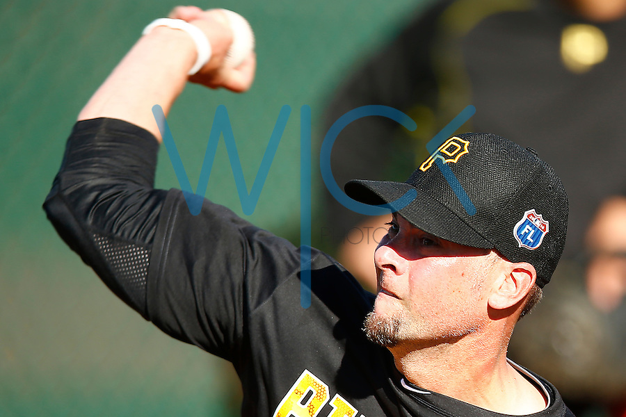 Ryan Vogelsong #14 of the Pittsburgh Pirates pitches in the bullpen during spring training at Pirate City in Bradenton, Florida on February 17, 2016. (Photo by Jared Wickerham / DKPS)