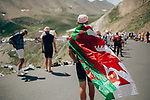 A Welsh fan waits for the race and Geraint Thomas (WAL) Team Ineos to arrive Stage 18 of the 2019 Tour de France running 208km from Embrun to Valloire, France. 25th July 2019.<br /> Picture: ASO/Thomas Maheux | Cyclefile<br /> All photos usage must carry mandatory copyright credit (© Cyclefile | ASO/Thomas Maheux)