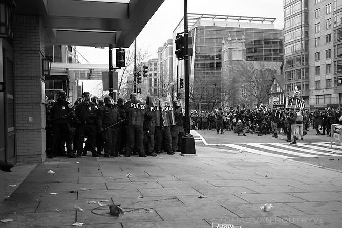 Police in riot gear form a line after clashes with a group of back-clad protestors, several hours after Donald Trump became president of the United States of America in Washington, DC on Inauguration Day, Jan. 20, 2017.