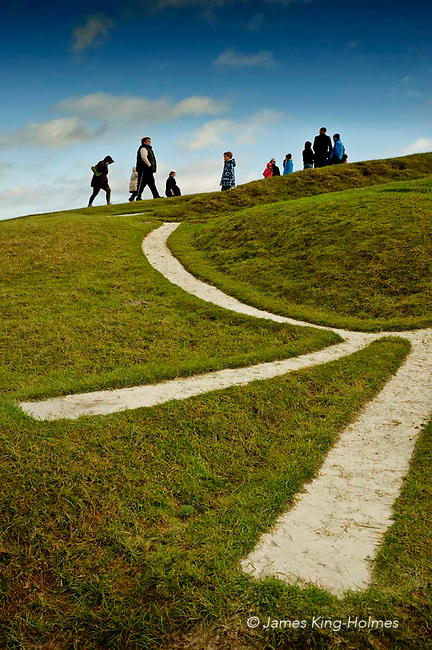 Visitors to the Uffington White Horse on New Year's Day 2013, showing a detail of the muzzle of the gigantic chalk figure of a horse dating from the late Bronze Age. The trenches which form the figure are filled with chalk and are regularly scoured to maintain the high visiblilty.