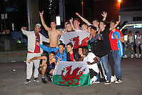 Teenagers in Swansea celebrate Wales' 3-0 win against Russia at the UEFA Euro 2016. Monday 20 June 2016