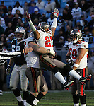 PANTHERS3.SP.121105.EDR.JPG  Tampa Bay's (#20, Ronde Barber, both cq) celebrates in the arms of teammate Chris Hovan (#95, both cq) after sacking Panthers quarterback Jake Delhomme in the fourth quarter of the Buccaneers' 20-10 win at Bank of America Stadium in Charlotte on Sunday, December 11, 2005. Barber earlier made a key interception deep in Panthers territory.  Watching are the Panthers' Jordan Gross (left, #69, both cq) and the Buccaneers' Michael Clayton (#80, both cq).  staff/Ted Richardson.