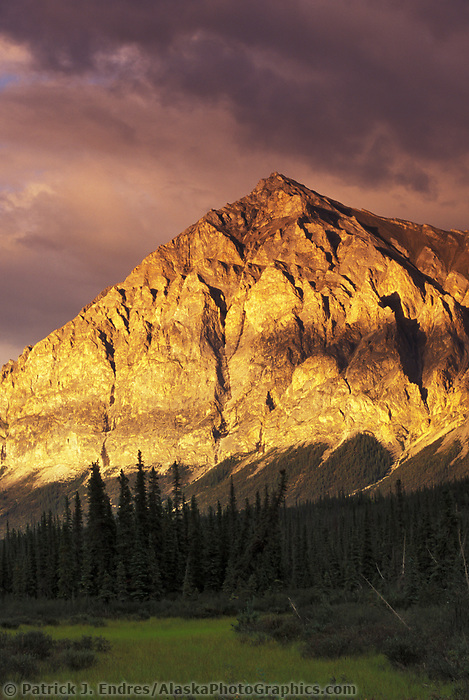 Late evening sun shines on the rugged face of mt Dillon, Brooks Range, Alaska
