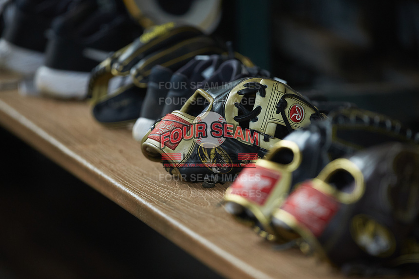 Rawlings baseball gloves are lined up on the bench in the Missouri Tigers dugout during the game against the Texas Longhorns in game eight of the 2020 Shriners Hospitals for Children College Classic at Minute Maid Park on March 1, 2020 in Houston, Texas. The Tigers defeated the Longhorns 9-8. (Brian Westerholt/Four Seam Images)