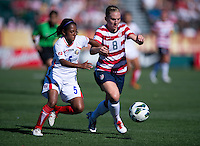 Amy Rodriguez (8) of the USWNT pushes away from Diana Saenz (5) of Costa Rica during a friendly match at Sahlen's Stadium in Rochester, NY.  The USWNT defeated Costa Rica, 8-0.