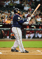 May 9, 2010; Phoenix, AZ, USA; Milwaukee Brewers first baseman Prince Fielder hits a home run in the second inning against the Arizona Diamondbacks at Chase Field. Players are wearing pink arm bands and using pink bats in honor of breast cancer awareness and Mothers Day. Mandatory Credit: Mark J. Rebilas-
