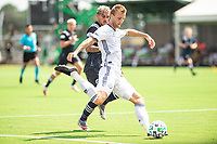 LAKE BUENA VISTA, FL - JULY 9: Kacper Przybylko #23 of the Philadelphia Union kicks the ball during a game between New York City FC and Philadelphia Union at Wide World of Sports on July 9, 2020 in Lake Buena Vista, Florida.