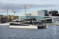 Sightseeing vessel, Vision of The Fjords, in Oslo harbour, next the the Opera.  During sightseeing the vessel will be powered by batteries only, while in transit it can use diesel engines to increase the range. The batteries can be charged ether by on-shore power or by the engines on board.<br /> <br /> The hybrid-electric carbon fiber catamaran is designed and built by Brødrene Aa. The ship is designed to carry 400 passengers and is normally operating in Nærøyfjord on the west coast of Norway.  <br /> <br /> © Fredrik Naumann/Felix Features