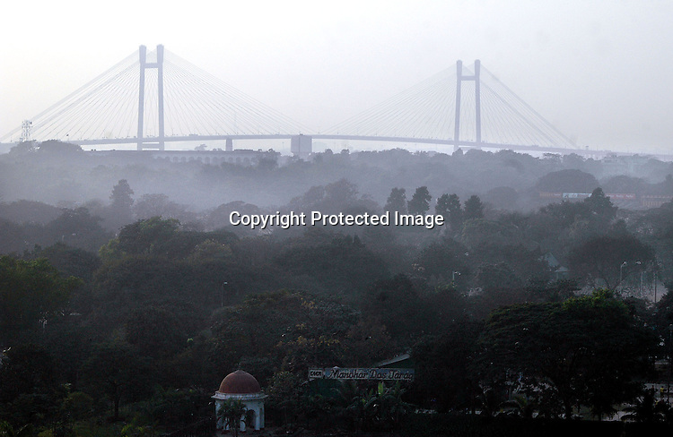 INDIA (West Bengal - Calcutta)  2007, 2nd Hooghly bridge (Vidyasagar Setu) seen through smog.  Pollution level rises during winter according to the experts.  A recent report by CNIC (CHITTARANJAN NATIONALCANCER INSTITUTE)  one of the most prominent cancer Institue of the country declairs Calcutta has the most air pollution in the country and 70% of its population suffers from respiratory and lung diseases. - Arindam Mukherjee