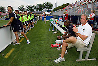 Washington Freedom head coach Jim Gabarra and assistant coach Clyde Watson watch the team before the game at the Maryland SoccerPlex in Boyds, Maryland.  The Washington Freedom defeated Sky Blue FC, 3-1, to secure a place in the playoffs.