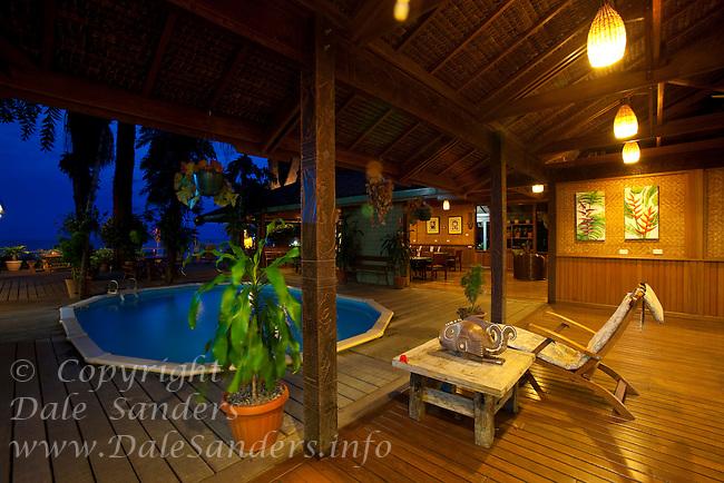 Walindi Resort pool and dining area at dusk, New Britain Island, Papua New Guinea.