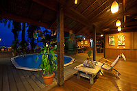 Walindi Resort pool and dining area at dusk, New Britain Island, Papua New Guinea.